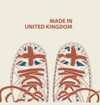 banner with white sneakers and words made in uk vector image vector image