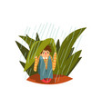 boy hiding from the heavy rain in the tall grass vector image vector image