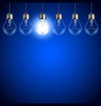 Light bulbs on dark blue background vector image vector image