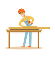 young carpenter man drilling wood in his workshop vector image vector image