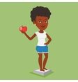 Woman standing on scale and holding apple in hand vector image vector image
