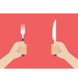 Knife and fork cutlery in hands vector image