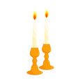 two candlesticks with candles vector image vector image