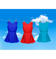 set of colored dresses hanging on a clothesline vector image