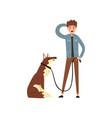 young man walking his pet dog vector image vector image