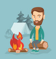 man sitting on log near campfire in the camping vector image vector image