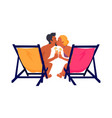 couple sits on recliners with cocktails and kisses vector image