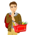 Thoughtful young man holding shopping basket vector image vector image