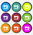 Sewing machine icon sign Nine multi colored round vector image