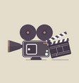 retro movie camera and movie clapper vector image vector image