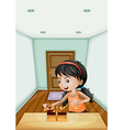 A girl unwrapping the gift inside the room vector image vector image
