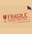 grunge fragile sign stamp on carton box vector image vector image