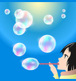 girl blows bubbles from the straw vector image