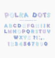 Cute polka dots font in pastel blue paper cutout