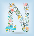 floral letter n with blue ribbon vector image vector image