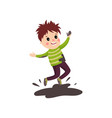 overactive kid in soiled sweater and pants jumping vector image vector image