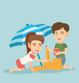 friends building a sandcastle on the beach vector image vector image