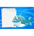 A shark with an empty bondpaper under the sea vector image vector image