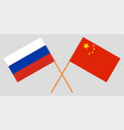 crossed russia and republic of china flags vector image