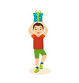 boy in festive mood cheerful holding gi vector image vector image