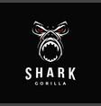 aggressive powerful gorilla and shark logo icon vector image
