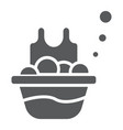basin with clothes glyph icon laundry and vector image vector image