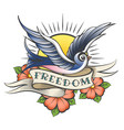Old school tattoo with bird and wording freedom