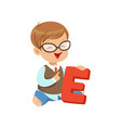 toddler boy doing speech game exercises on letter vector image vector image