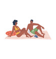 couple in swimsuits sitting on blanket on beach vector image vector image