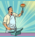 cook blacksmith forges a burger on the anvil vector image vector image