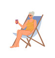 mature woman sits on chaise lounge with cocktail vector image vector image