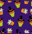 cartoon cupcakes with a ghost and a witch s hat vector image vector image