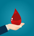 hand holding a blood drop vector image vector image