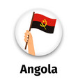 angola flag in hand round icon vector image vector image