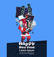 santa claus holding pile of modern electronics vector image