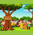 happy children are playing near the big tree vector image vector image