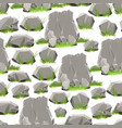 cartoon stones with grass seamless pattern vector image