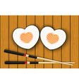 Heart-shaped sushi and chopsticks vector image vector image