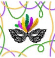 mardi gras mask with feathers on a colored bead vector image vector image