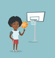 young african basketball player spinning a ball
