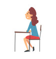 girl student sitting at desk in classroom and vector image vector image