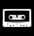 white silhouette of audio cassette on black vector image