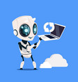 modern robot hold laptop computer updating on blue vector image vector image