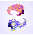 Female faces silhouettes with floral hair vector image
