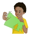 African American boy cuts paper with scissors vector image vector image