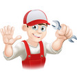 happy plumber or mechanic with spanner vector image vector image