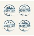 Mountain tourism logos vector image