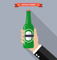 Hand holds a bottle of beer vector image vector image