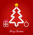 Christmas card with folded paper tree on a red vector image vector image