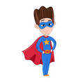 little boy in superman costume and red cloak vector image vector image
